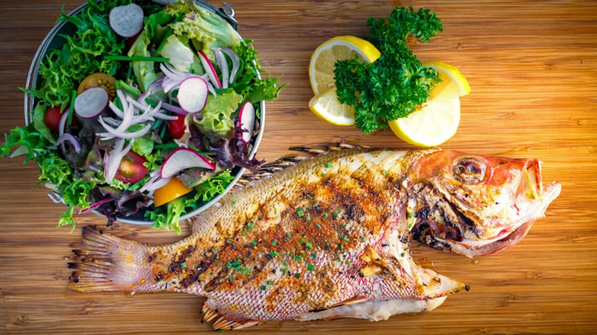 Salt crusted whole sea bass baked with fresh aromatic for Aromatic herb for fish